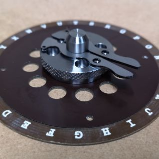 Engraved letter disc and machined drive components