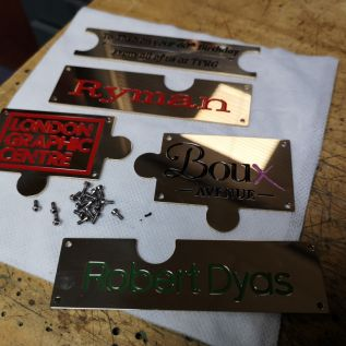 Engraved Brass pieces representing Theo's Brands